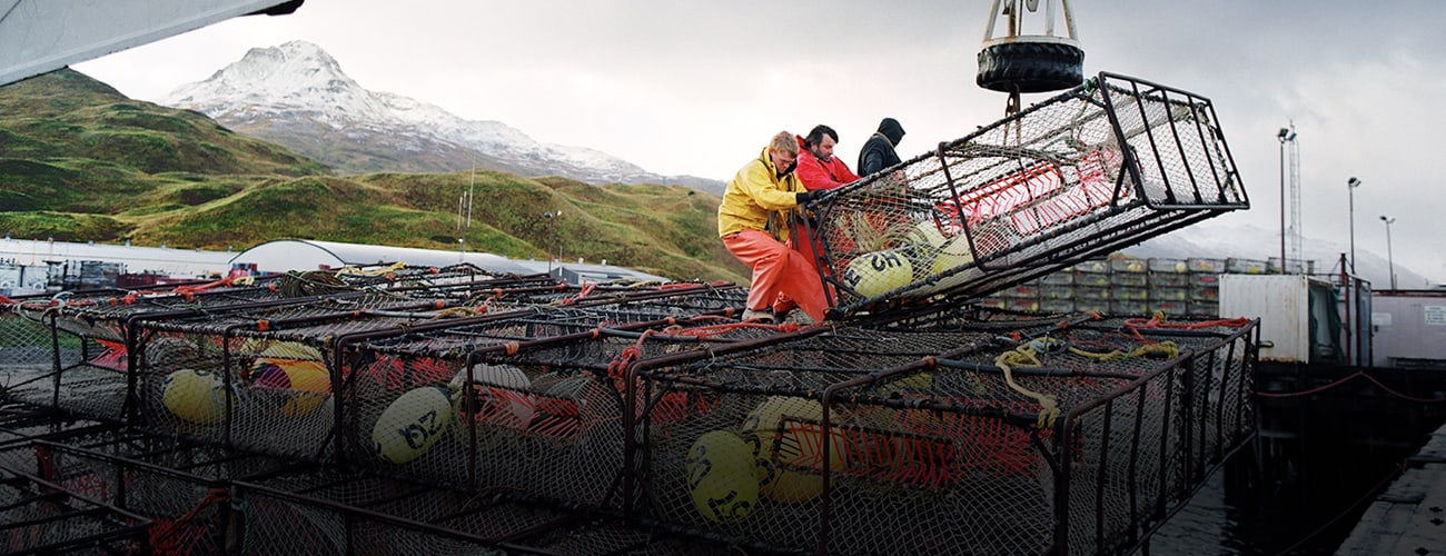 Stacking Crab Pots in Alaska by Corey Arnold